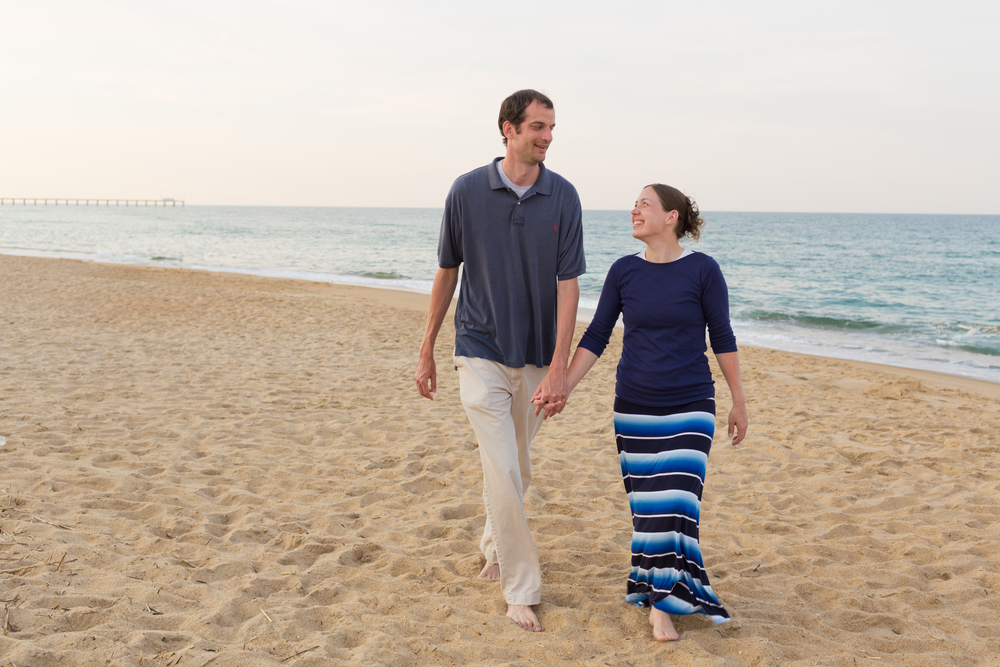 Couple holding hands, walking on beach (Outer Banks romantic portrait)