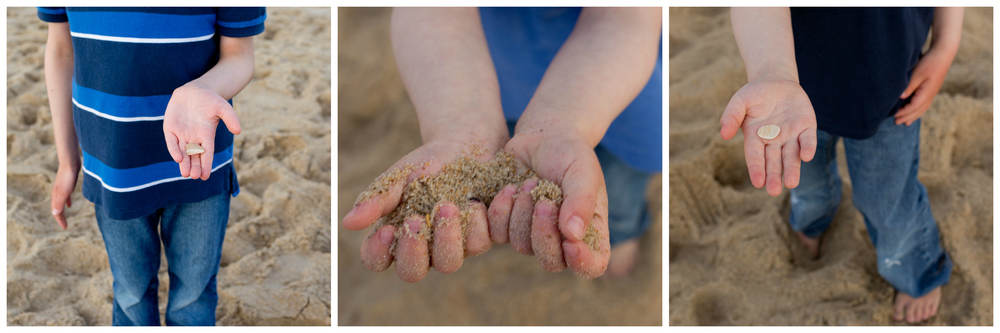 little boy hands holding sand and shells at beach