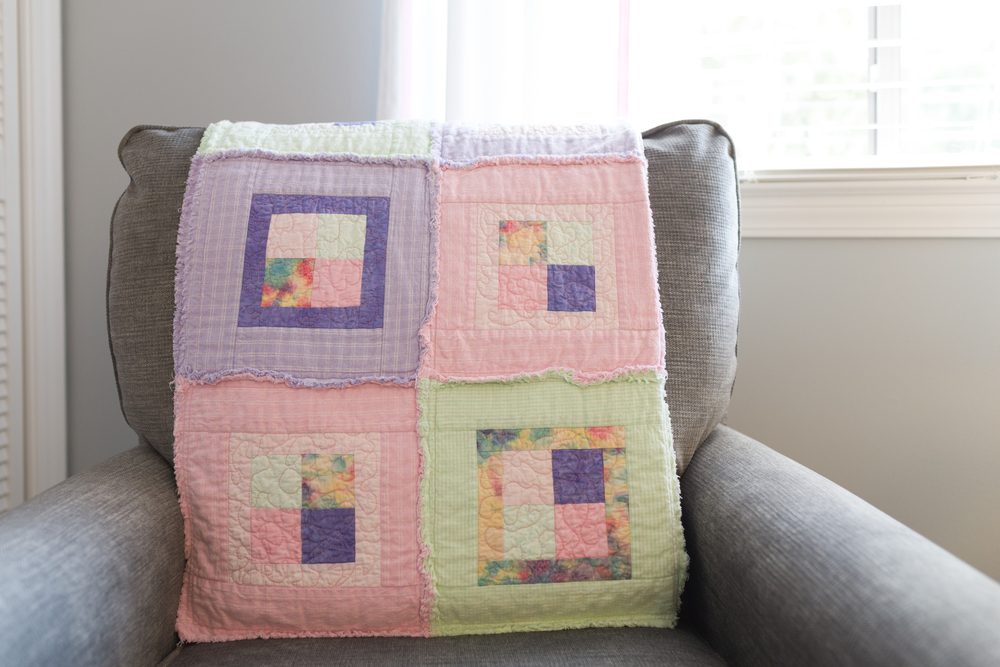 handmade baby quilt in pastel purple, pink, green