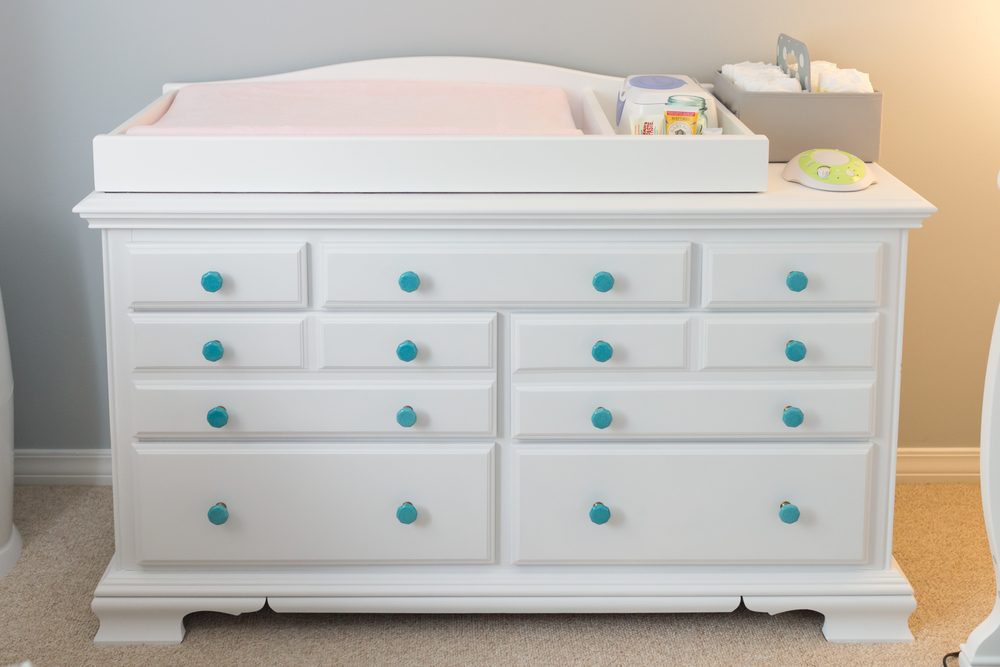 repainted dresser changing table for baby girl nursery (white with aqua knobs)