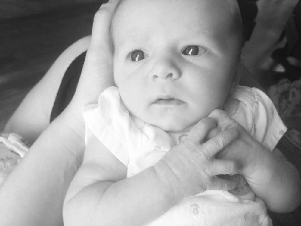 baby with serious look on face (black and white)