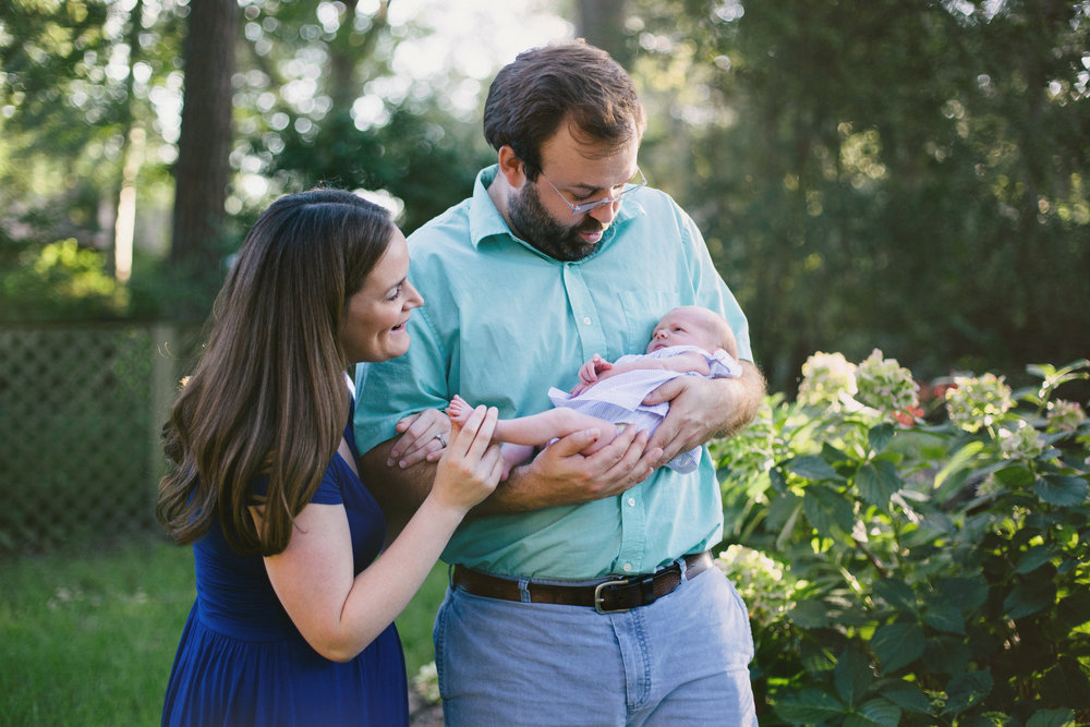 family photo in backyard (parents with newborn baby girl)