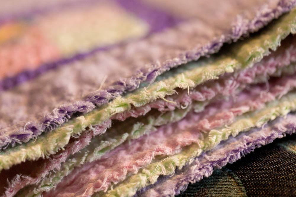 edges of pastel baby quilt (pink, green, purple)