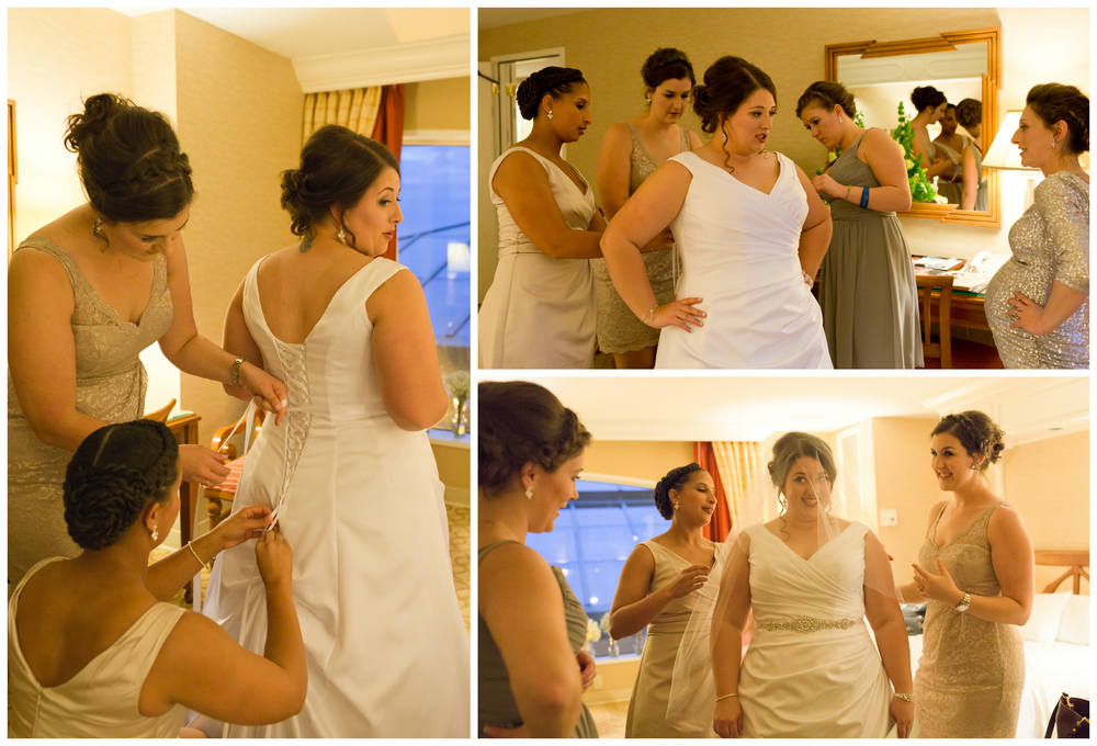 bridesmaids helping bride put on wedding dress in hotel room