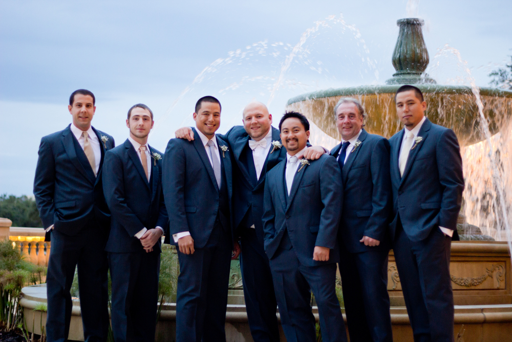 groom and groomsmen with fountain at Beau Rivage