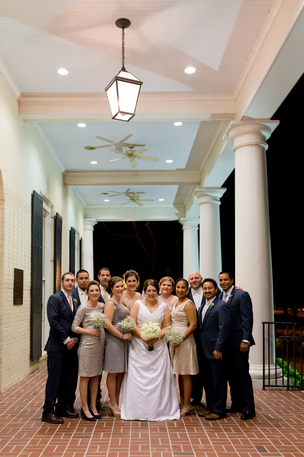 wedding party group photo at Biloxi Visitors Center porch at night