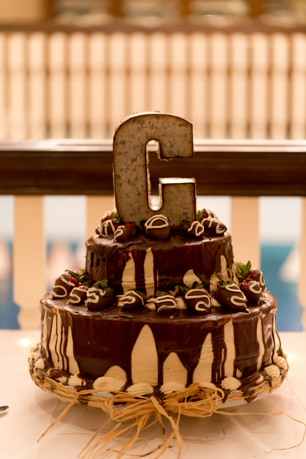 chocolate and stawberry ganache wedding cake with monogram C initial cake topper