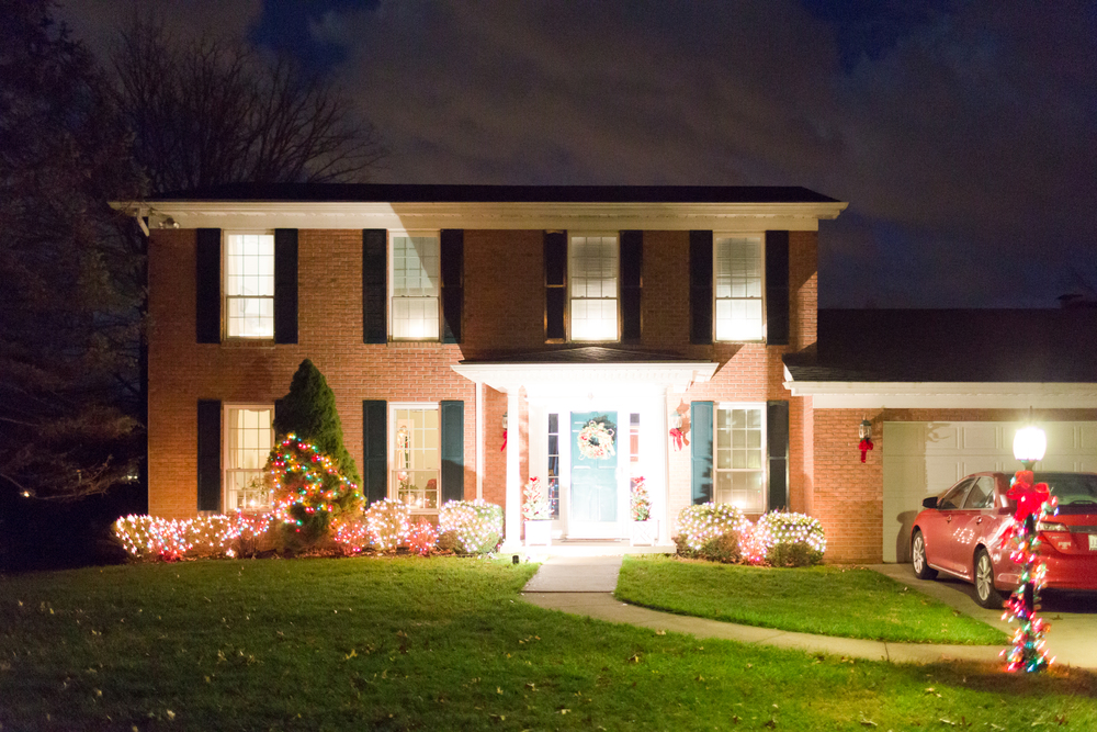 brick house exterior with Christmas lights