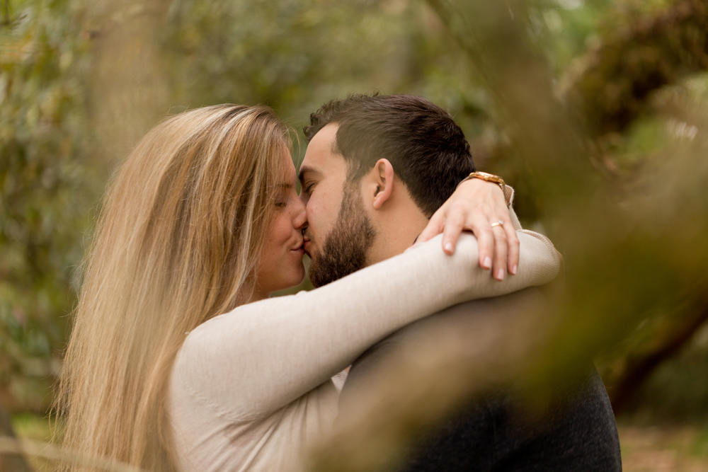 romantic engagement portrait (kissing in the woods)