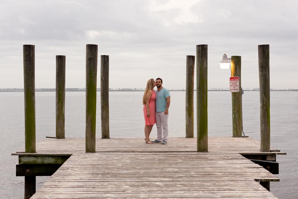 nautical engagement photo on dock