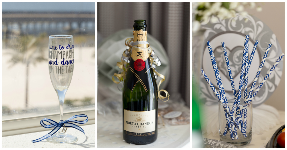 wedding preparation details (champagne bottle ,glass, and straws)