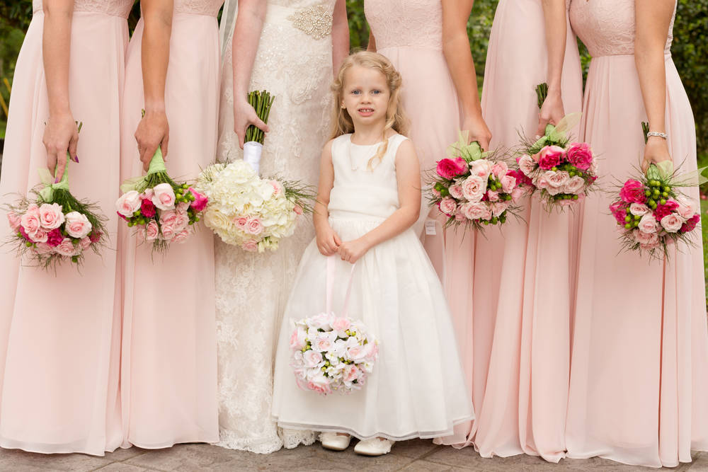 flower girl photo with bridesmaids bouquets (Uninvented Colors Photography)