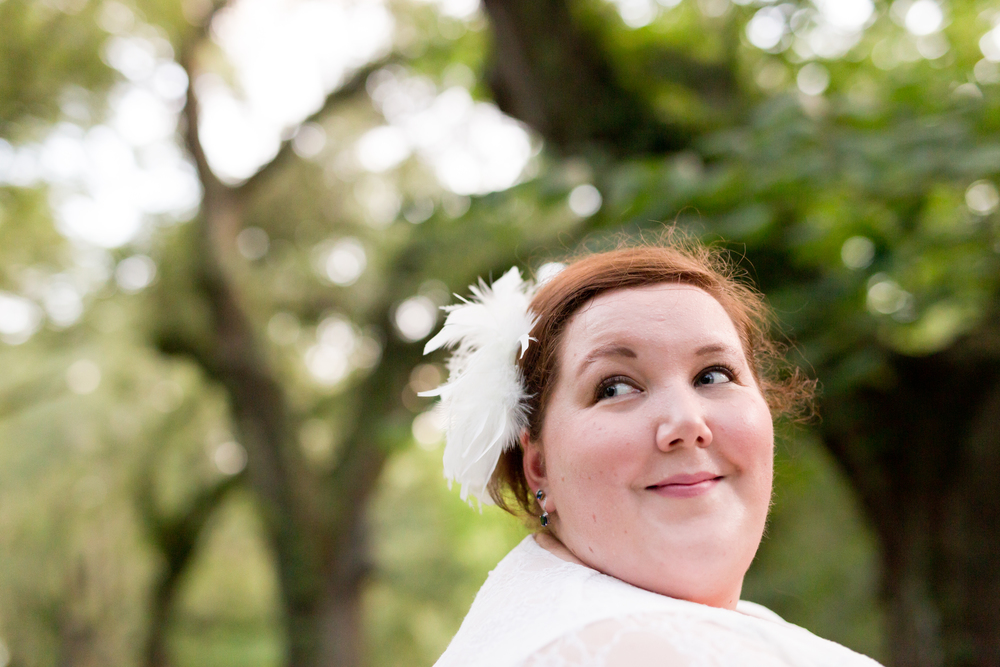 beautiful smiling bride with feather headpiece