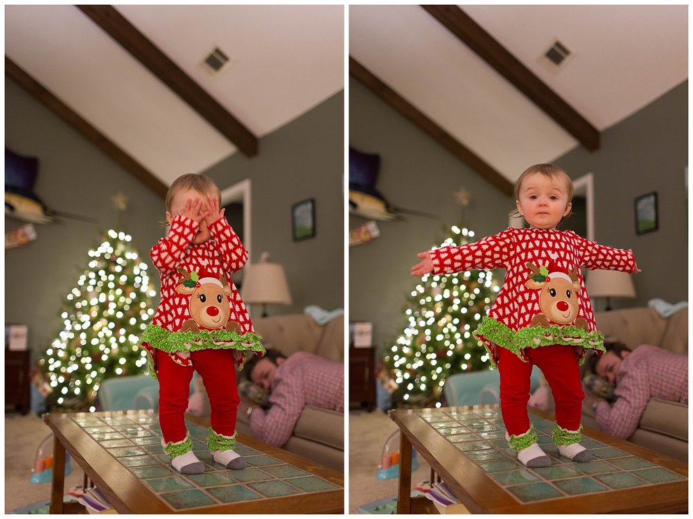 toddler girl playing peekaboo at Christmas time