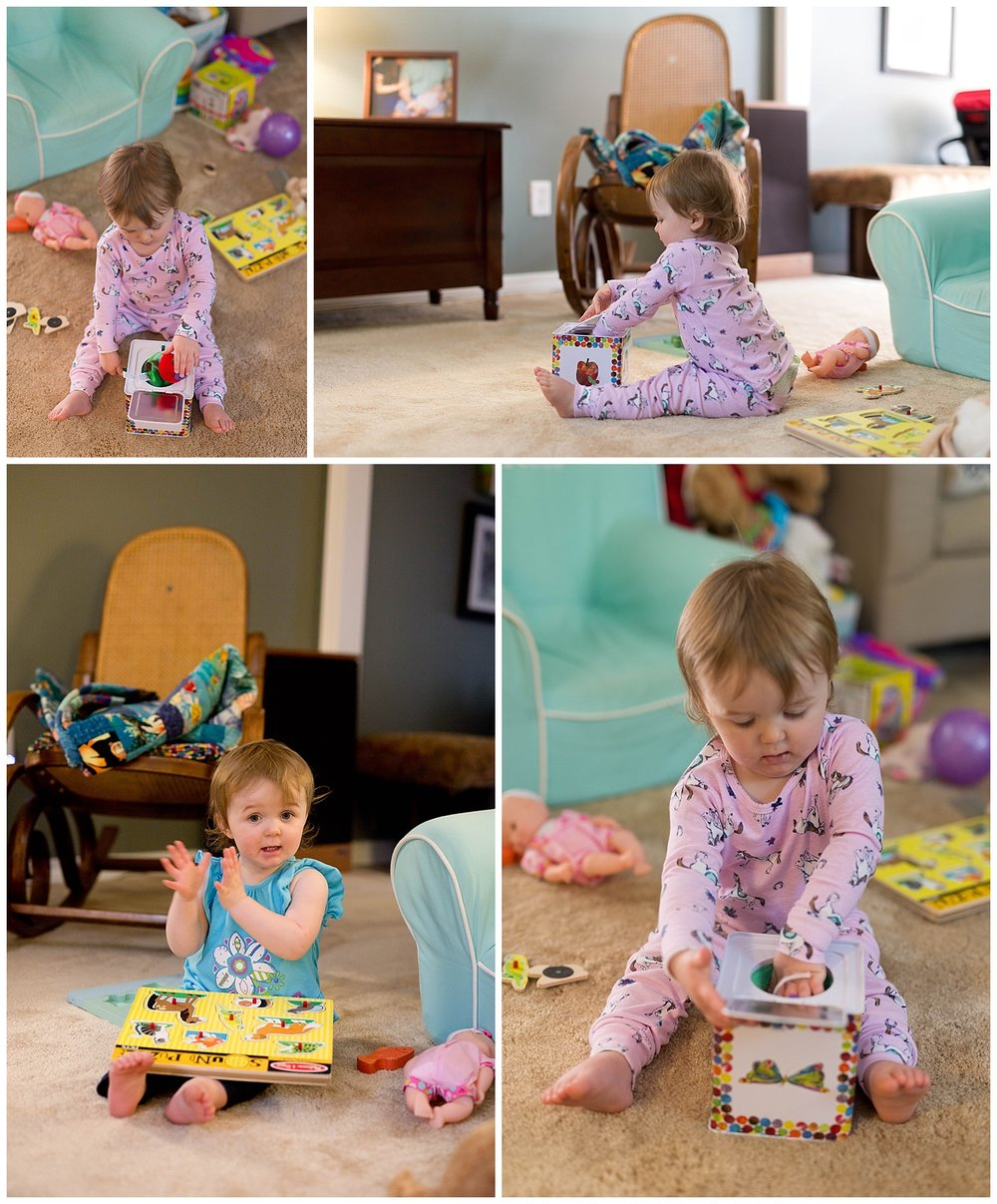 toddler girl playing with jack-in-the-box and puzzle