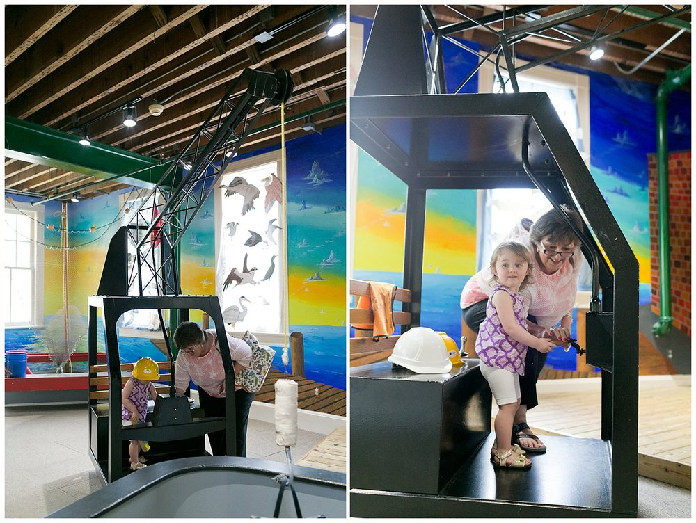 grandmother and toddler granddaughter with crane at Lynn Meadows Discovery Center