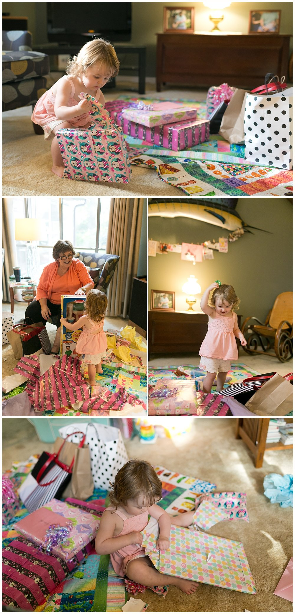 two-year-old girl opening birthday presents