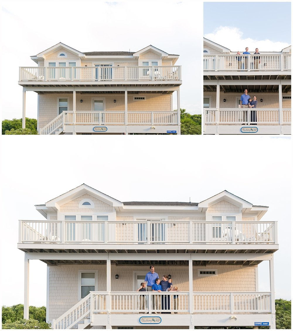 family posing on front porch of beach house