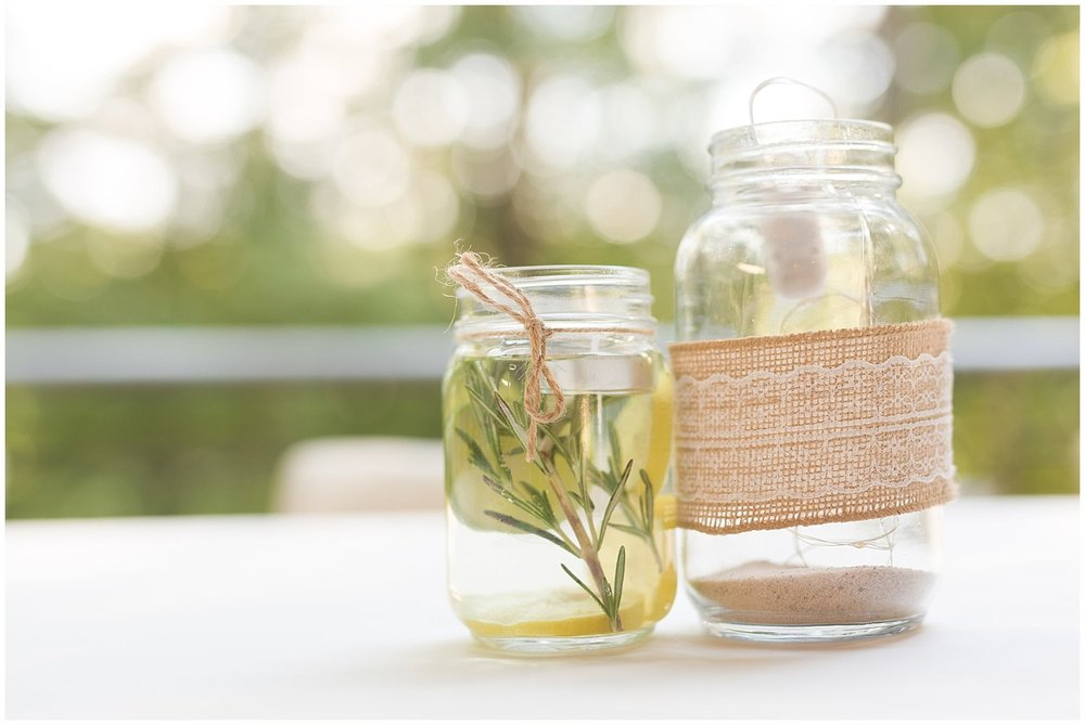 DIY mason jar centerpieces for outdoor camp wedding