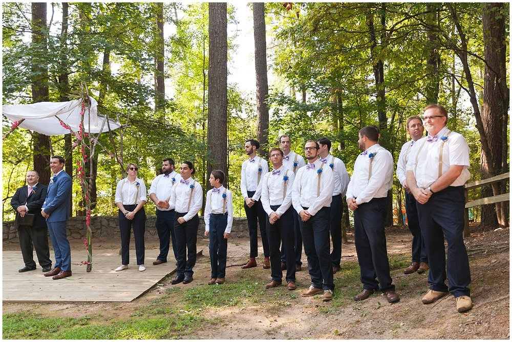 large group of groomsmen at outdoor wedding