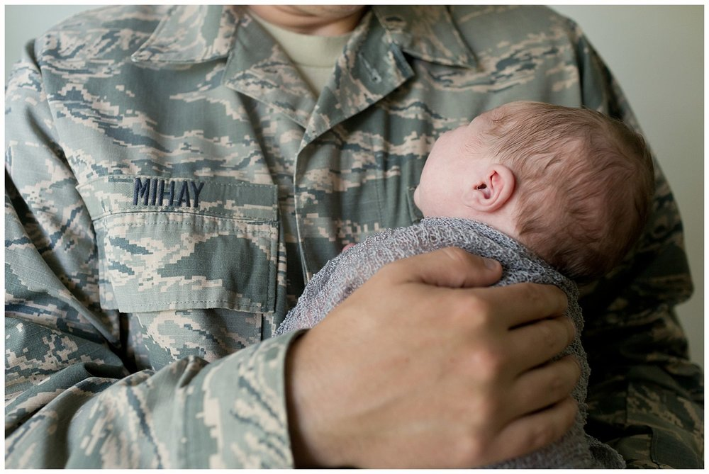 dad holding baby in USAF uniform