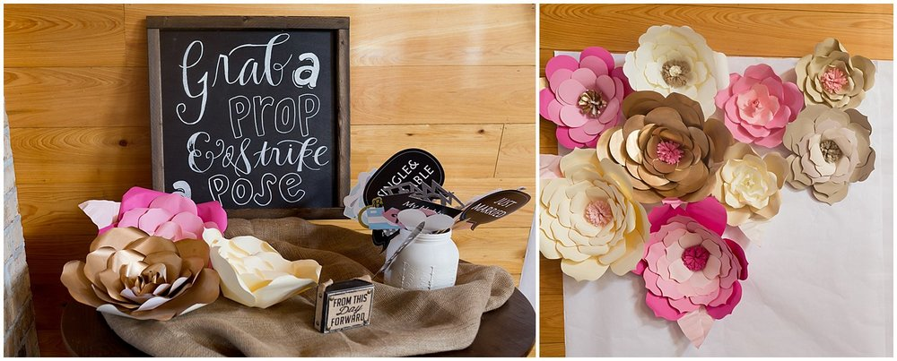 wedding photo booth with chalkboard sign, props, and paper flowers