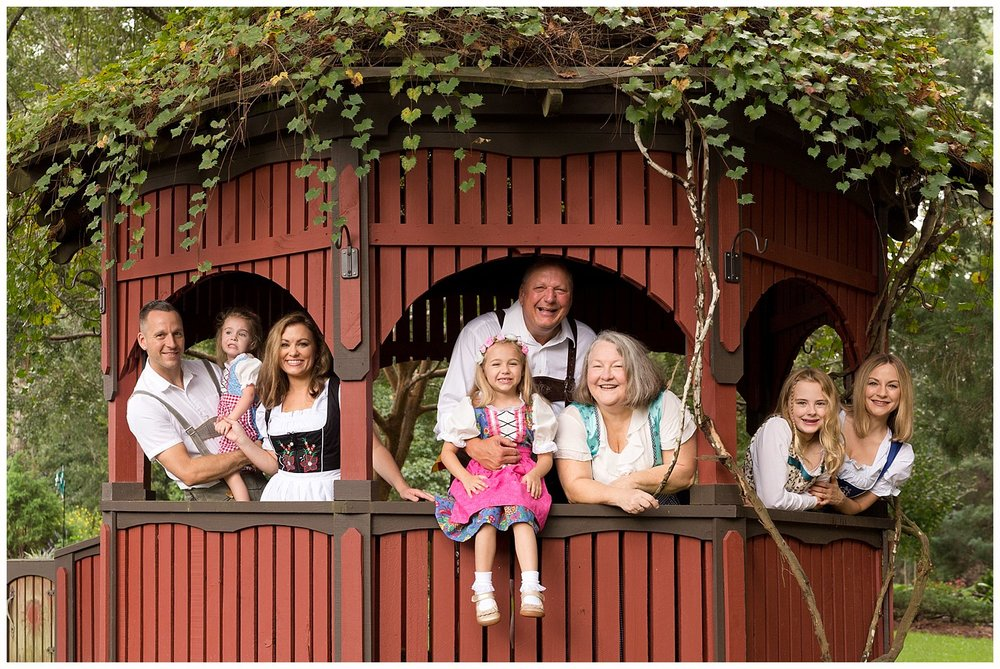 extended family photo with authentic German dirndl and lederhosen in Ocean Springs, MS