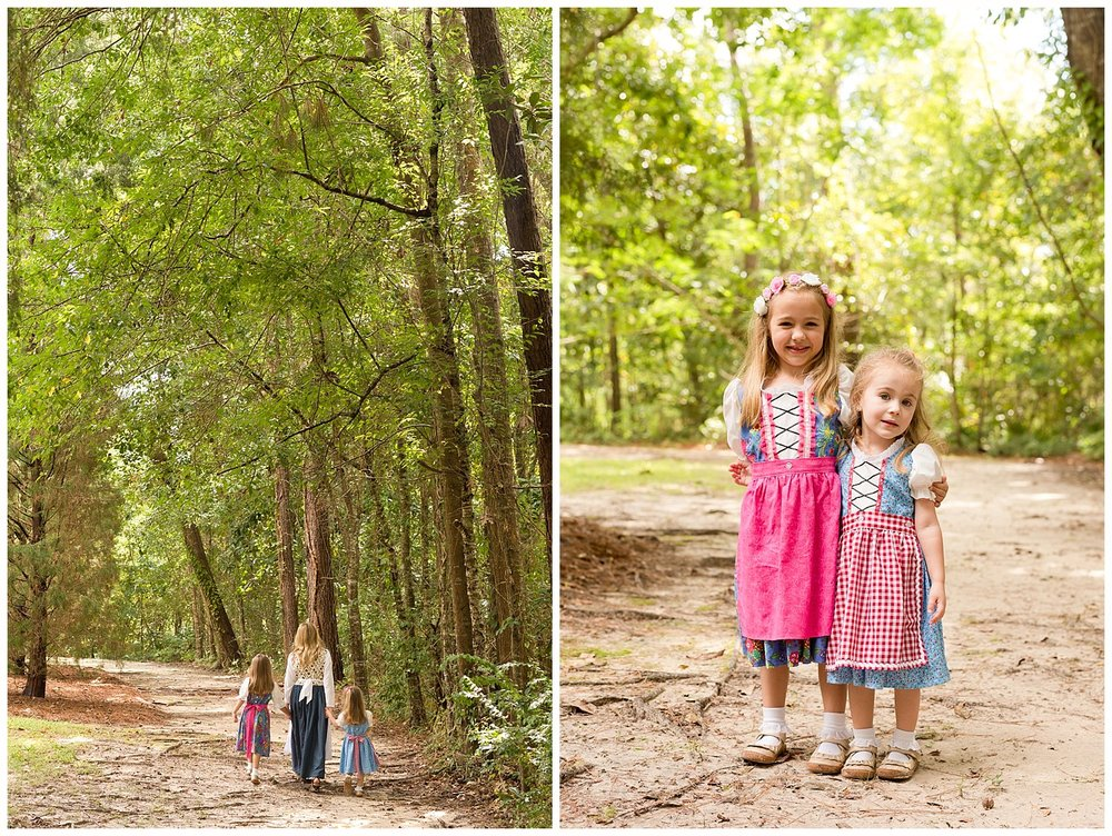 sisters and cousin in dirdnl dresses in the woods