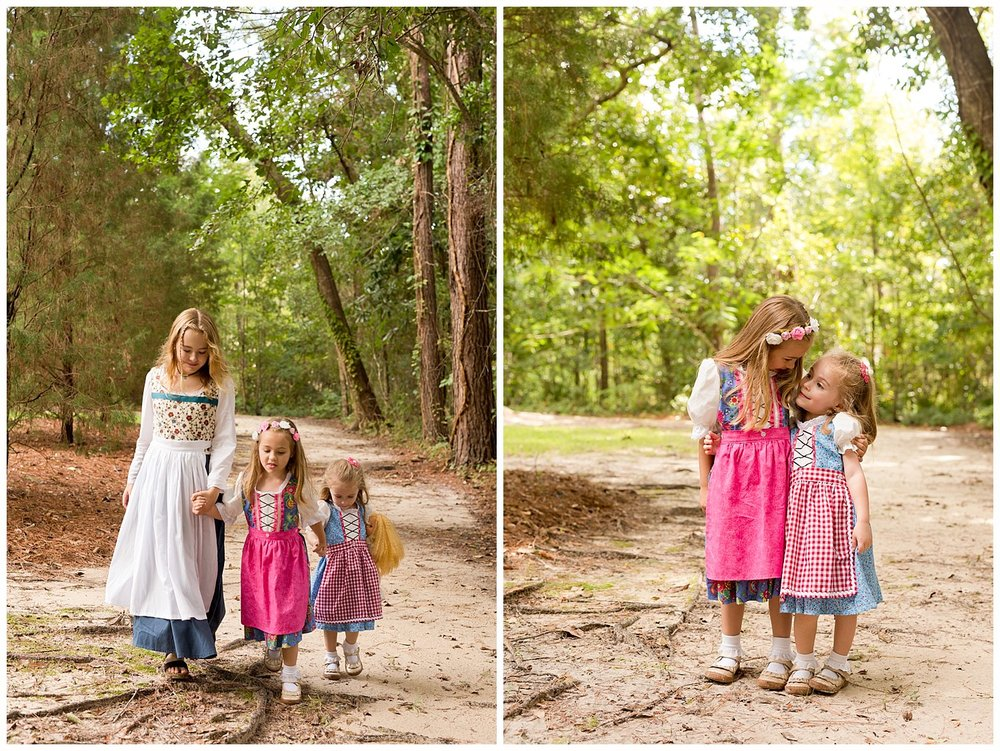 cousins and sisters in the woods with authentic German dresses - Ocean Springs, MS photographer