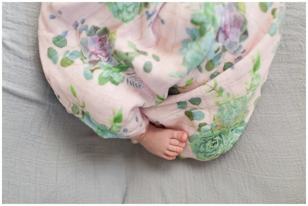 sweet little baby foot sticking out of floral swaddle blanket - Ocean Springs photographer