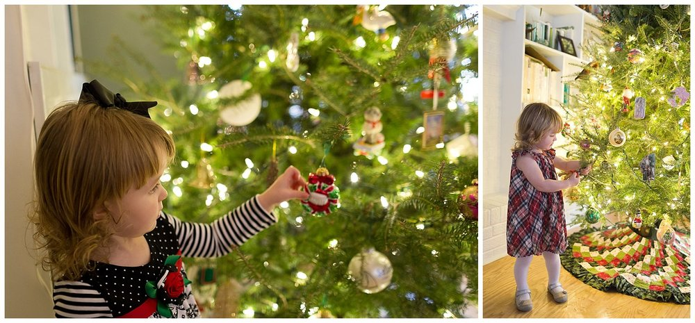 toddler girl playing with Christmas ornaments on tree