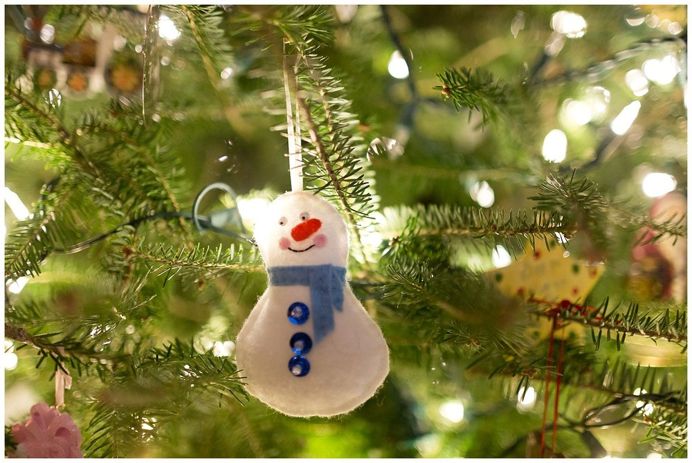 snowman Christmas ornament on tree