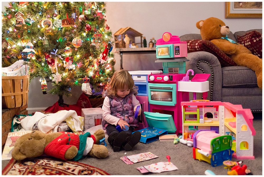 little girl playing with new Christmas toys