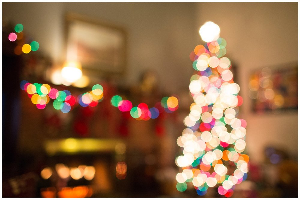 colorful Christmas lights on tree and fireplace mantel