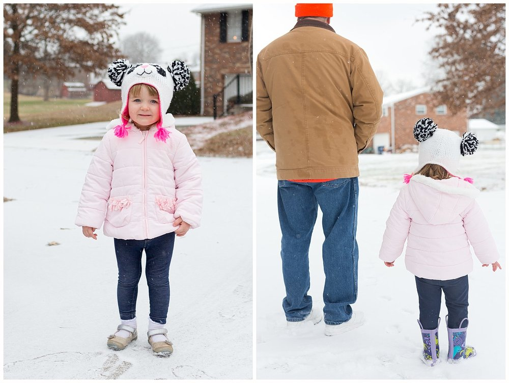 two year old girl and granddaddy in the snow
