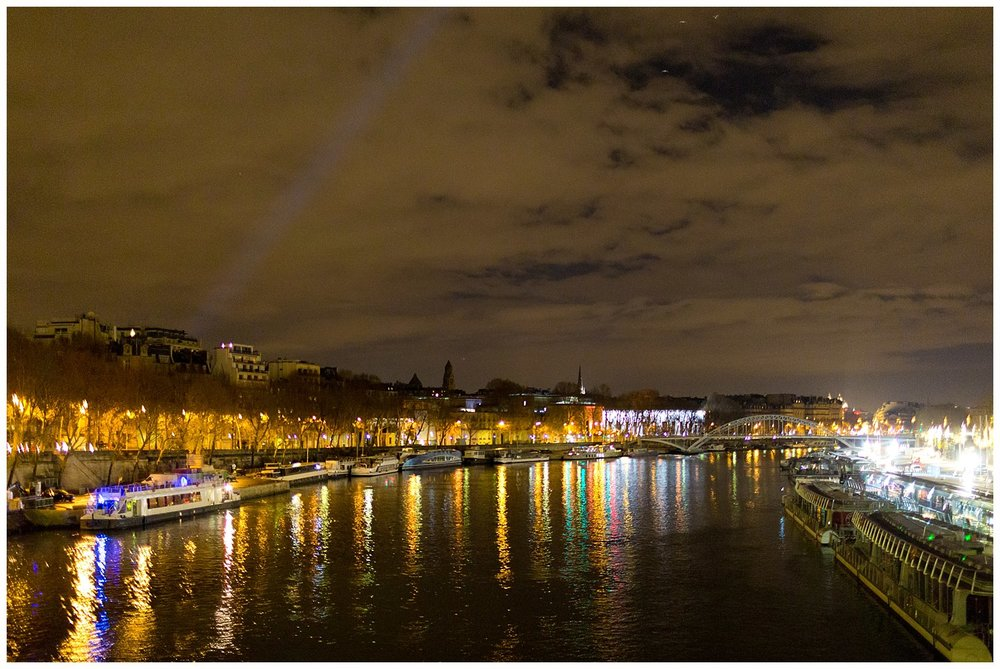 view from bridge over river Seine in Paris at night