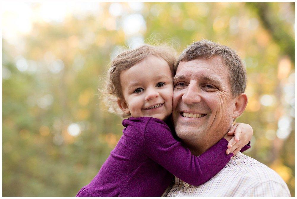 cute little girl hugging daddy