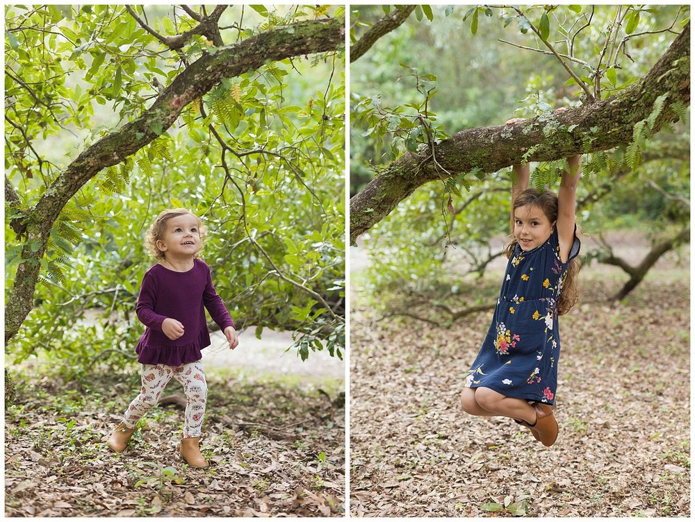 little girls playing on live oak branches