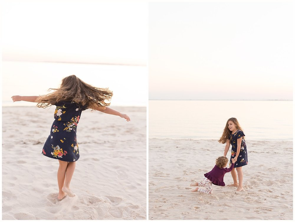 little girls twirling and spinning on the beach