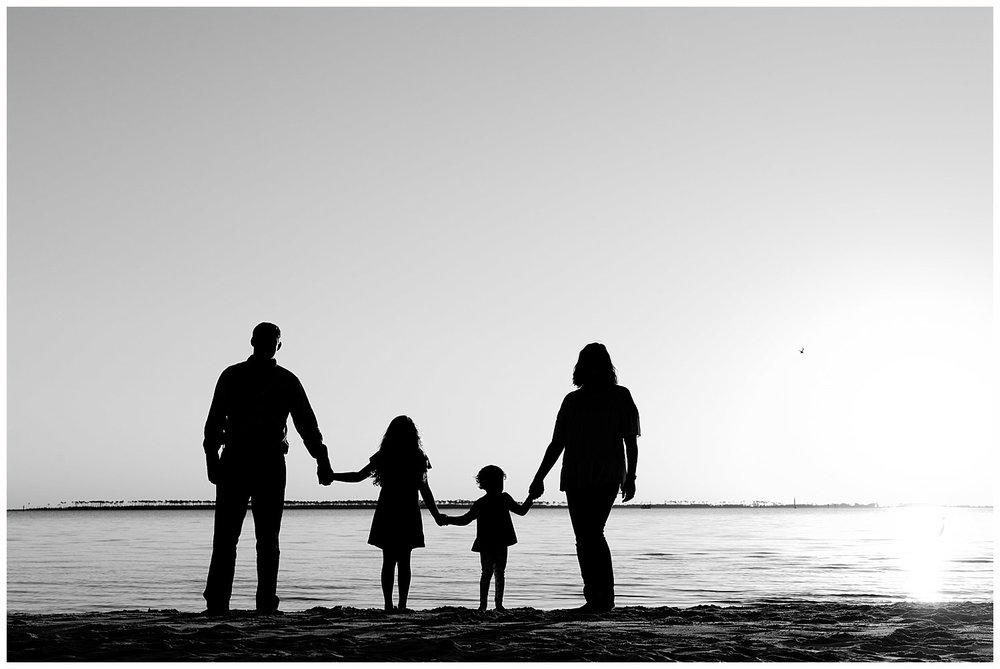 family silhouette on the beach  - Ocean Springs family photographer