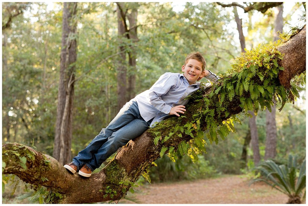 cute picture of tween boy climbing tree