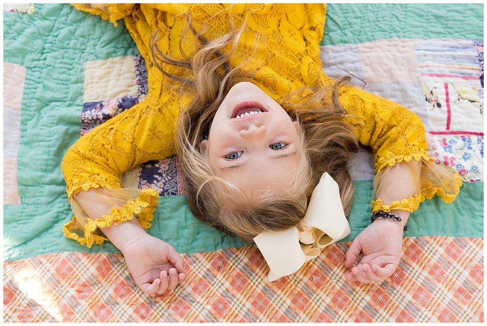 Ocean Springs photographer - colorful portrait of little girl on vintage quilt