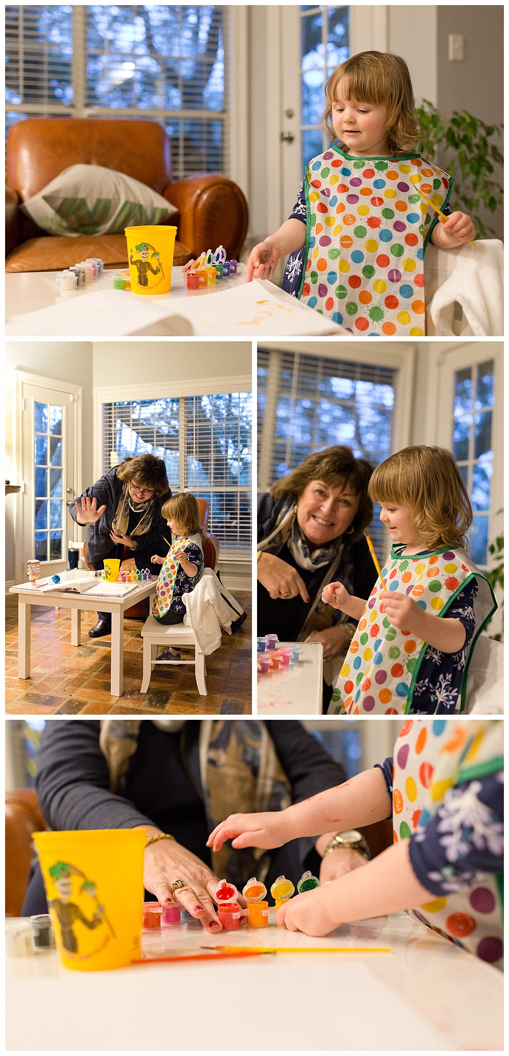 two-year-old girl painting with grandmother