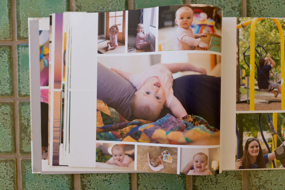 photo book with pictures of baby girl playing at home - Ocean Springs lifestyle photographer