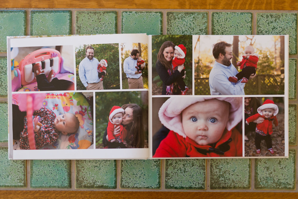 family photo book with cute baby girl pictures with parents - Ocean Springs, Mississippi photographer