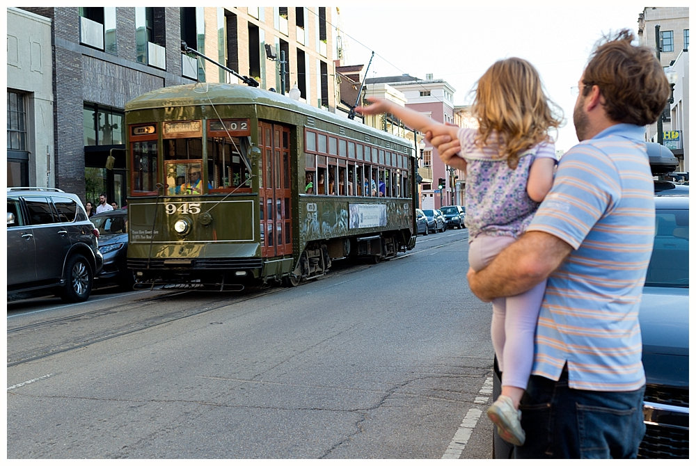 little girl waving to trolley in New Orleans
