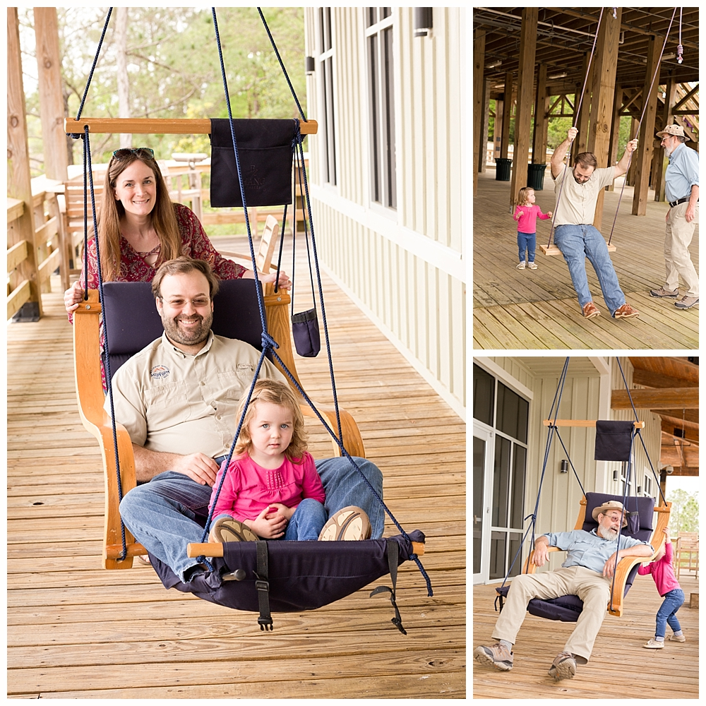 family playing on swings at MGCCC Estuarine Education Center