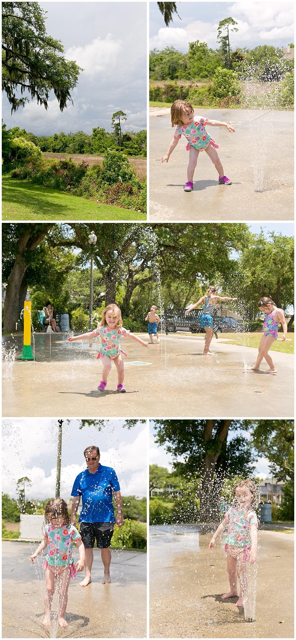 little girl playing at Fort Maurepas splash pad in Ocean Springs