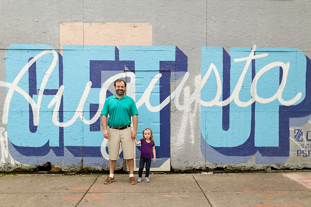 father and daughter with mural in Augusta, Georgia