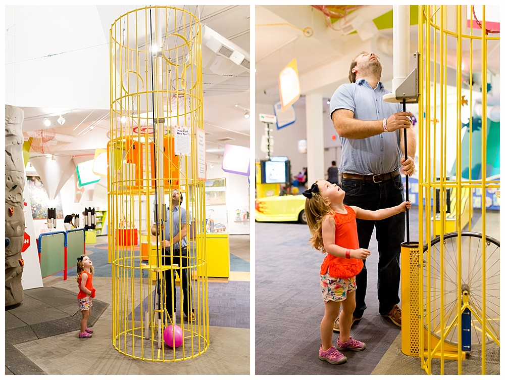 little girl and dad playing with physics exhibits at Strong National Museum of Play